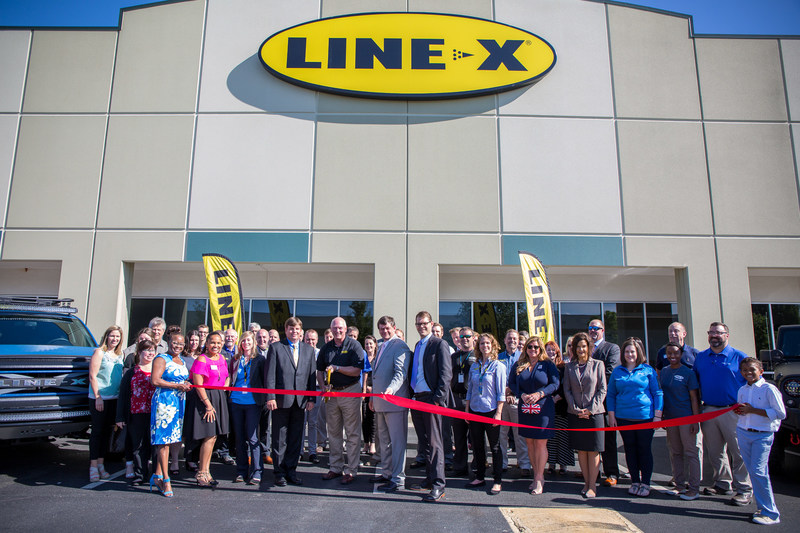 Dennis Weese, President of LINE-X, cuts the ribbon officially dedicating the new corporate headquarters.