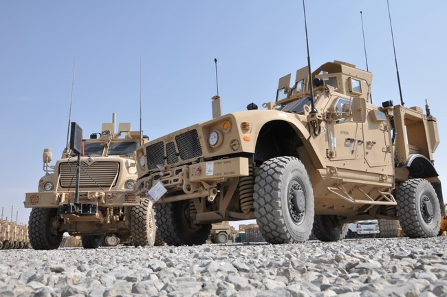 Two MRAP vehicles with armored hulls designed and manufactured by Plasan