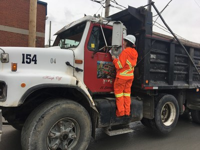 Toronto Hydro, the Electrical Safety Authority and GFL Excavating came together to hand out powerline safety stickers to dump truck drivers in Toronto today. (CNW Group/Toronto Hydro Corporation)