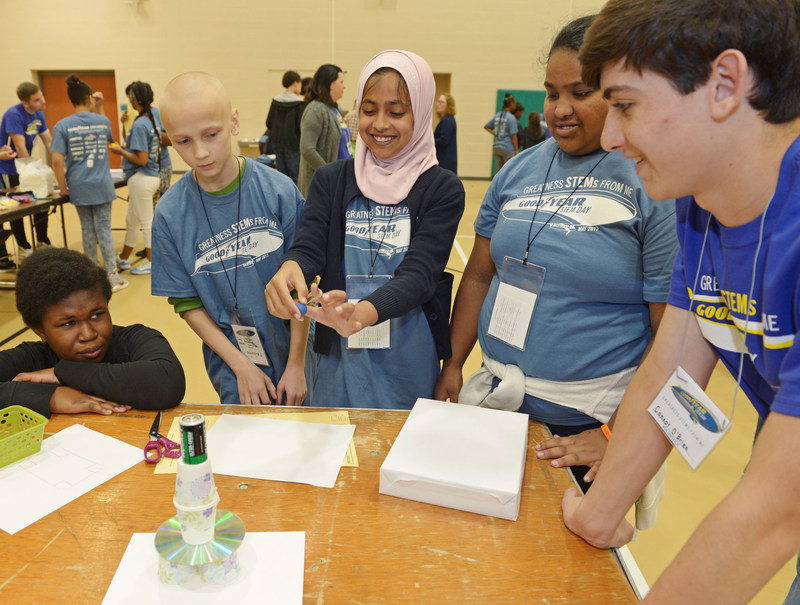 Jennings Middle School (Akron, Ohio) students (from left) Fadhilia Fofana, Seth Adams, Nadia Anwaar and Smita Biswa participate in a hands-on activity as volunteer and Akron Firestone High School student Connor O'Brian advises at The Goodyear Tire & Rubber Company's 19th Annual STEM Career Day.