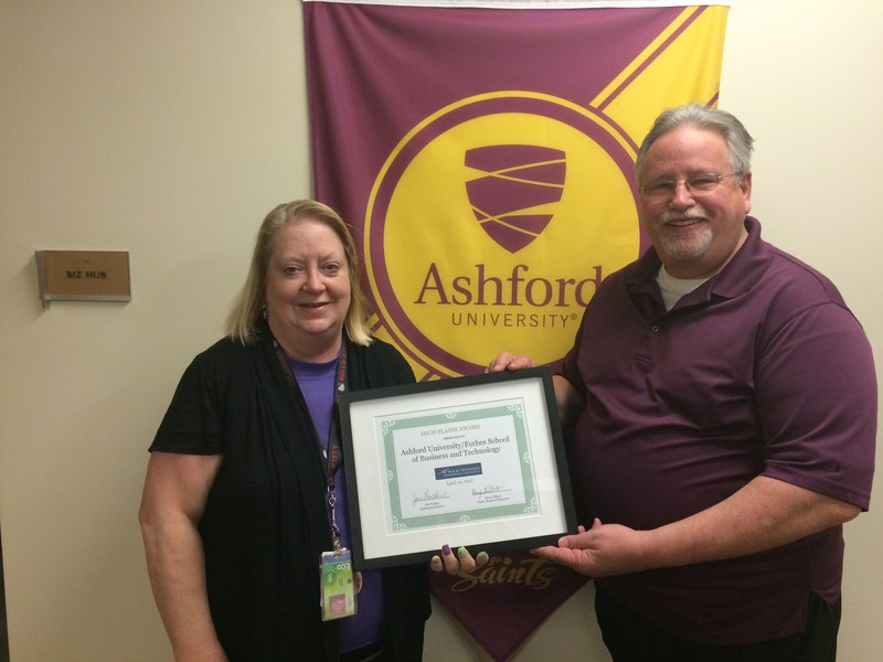 Forbes School of Business and Technology at Ashford University faculty members Drs. Andree Swanson and Ronald Beach with the High Plains Award.