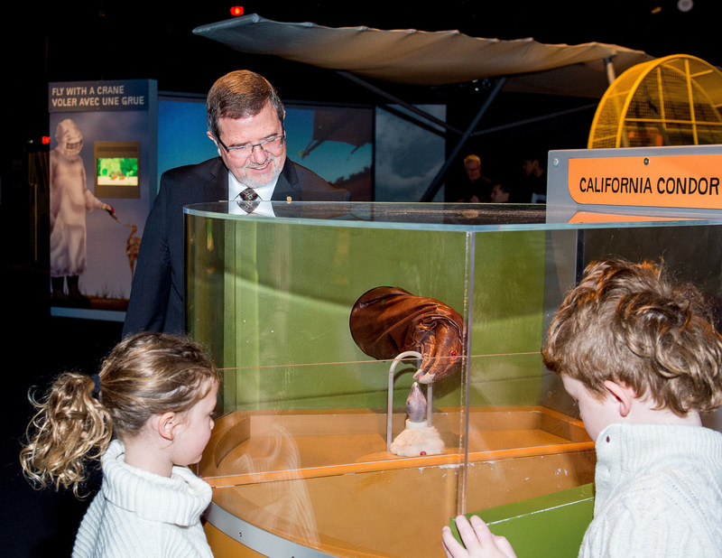 Ontario Science Centre CEO and Chief Science Officer Dr. Maurice Bitran teaches siblings Will (8) and Charlie (7) Pittard about animal conservation at Wildlife Rescue, opening May 18 at the Ontario Science Centre. (CNW Group/Ontario Science Centre)