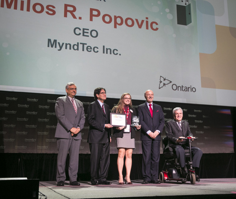 L-R Dr. Tom Corr, President and CEO of OCE, Michael J. Nobrega, Chair of the OCE Board, Alexa Granger who accepted the award on behalf of MyndTec Inc. Reza Moridi, Minister of Research Innovation and Science, and Hon. David Onley, Former Lieutenant Governor of Ontario (CNW Group/Ontario Centres of Excellence Inc.)