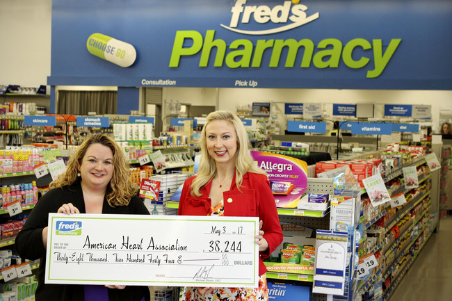 Jaime O'Bar, Director of Pharmacy Operations, fred's Pharmacy, left, presents fred's heart health campaign donation check to Holly Ford, Executive Director and Vice President, American Heart Association, at the at the Getwell Road fred's Pharmacy in Memphis, Tenn.