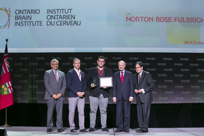 Mark Elias was presented with the Ontario Brain Institute's ONtrepreneur Pitch Challenge award by The Honourable Reza Moridi, Minister of Research, Innovation and Science and Dr. Tom Mikkelsen, President and Scientific Director of the Ontario Brain Institute on OCE Discovery's main stage at the Metro Toronto Convention Centre yesterday. Photographed from left to right at the presentation of the award is Dr. Tom Corr, President and CEO of the Ontario Centres of Excellence; Dr. Tom Mikkelsen, President and Scientific Director of the Ontario Brain Institute; Mark Elias, CEO of Steadiwear Inc.; The Honourable Reza Moridi, Minister of Research, Innovation and Science; and Michael Nobrega, Chair of the Ontario Centres of Excellence Board of Directors. (CNW Group/Ontario Brain Institute)