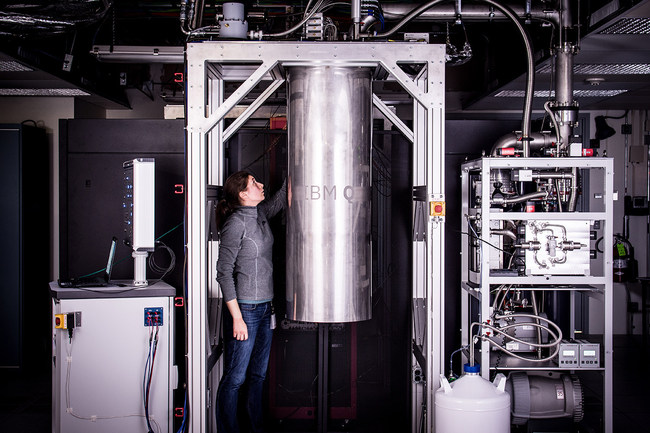 IBM Research Staff Member Katie Pooley, an Applied Physics PhD from Harvard who joined IBM in 2015, at the Thomas J Watson Research Center, is a process integrator on the IBM Q team. In the photo, Pooley is examining a cryostat with the new prototype of a commercial quantum processor inside.