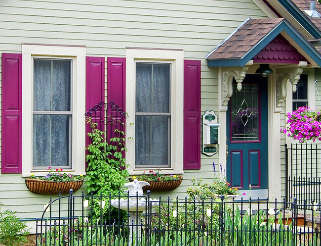 Adding bright pops of paint color to the entranceway, shutters, and trim can add visual interest to any home, according to the Paint Quality Institute.