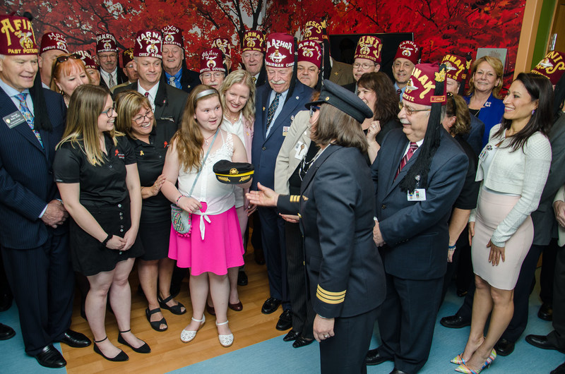 Ribbon cutting for the opening of the Air Canada Foundation's Patient Lounge at Shriners  Hospitals for Children -Canada with members of the Shriners Board of Directors, members of the Air Canada Foundation Board of Directors and Brittany Janes, a patient who flies on Air Canada wings. (CNW Group/Shriners Hospitals For Children)