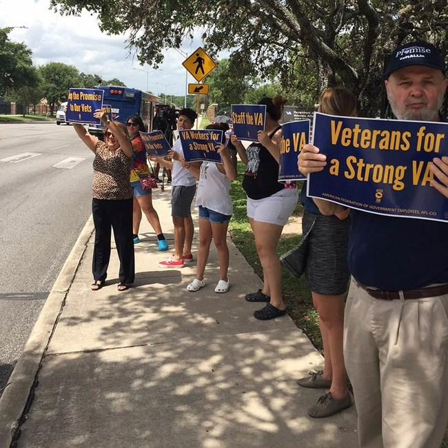 Veterans Affairs employees rally outside the Audie L. Murphy Memorial VA Hospital in San Antonio, Texas, on June 20 to protest the proposed closing of VA medical centers nationwide.