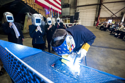 A welder authenticates the keel of LCS 19, the future USS St. Louis, by welding the initials of ship sponsor Barbara Broadhurst Taylor. The Keel Laying is the formal recognition of the start of the ship's module construction process.
