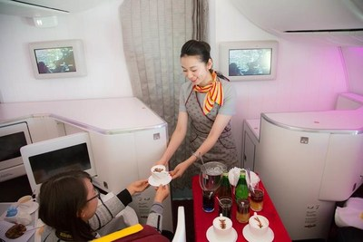 Air Attendant Serving Nespresso Coffee To Passengers