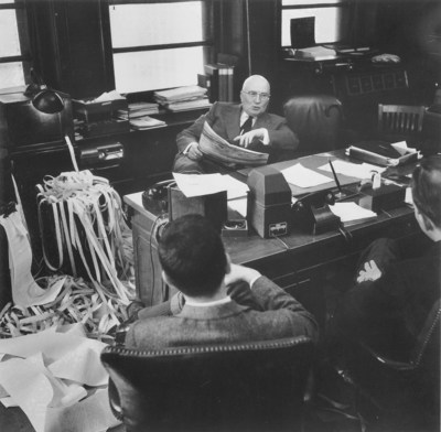 Gerald Loeb, at his desk, in his Midtown Manhattan office (c. 1950). Gerald Loeb was a founding partner of E.F. Hutton, a guest columnists for Forbes Magazine and widely considered a Wall Street iconoclast. The 2017 Loeb Awards will celebrate the 60th Anniversary of Gerald Loeb's legacy, announce the 2017 competition winners and honor two career achievement recipients on Tuesday, June 27 at Capitale in New York City. http://www.theloebawards.com