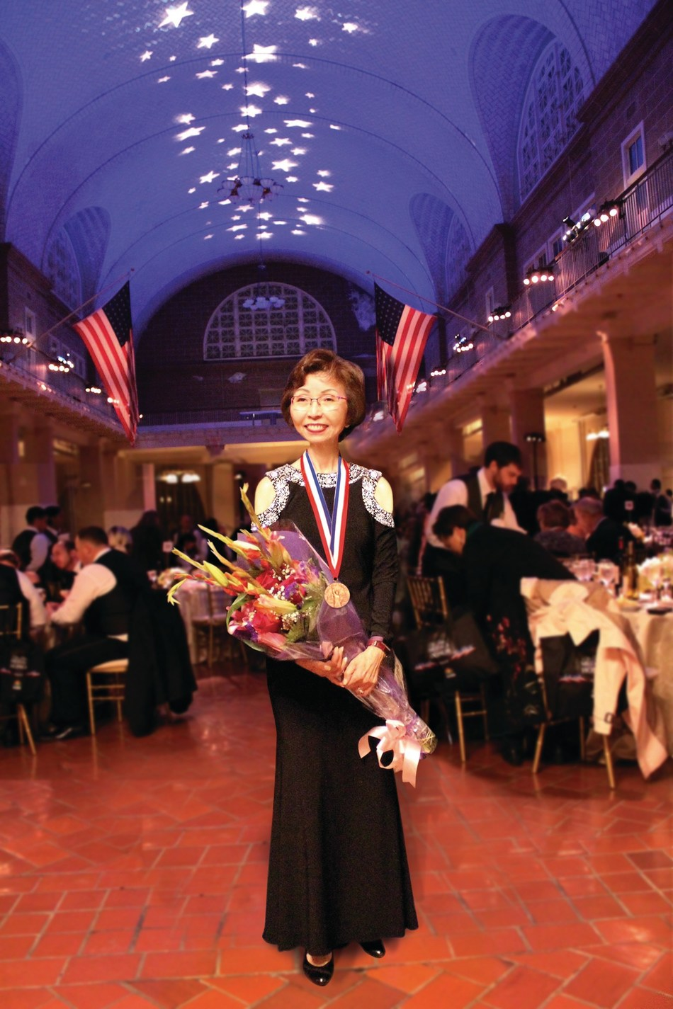 Veronica Tsang of Cathay Bank in the Ellis Island Gallery after being presented with the 2017 Ellis Island Medal of Honor.
