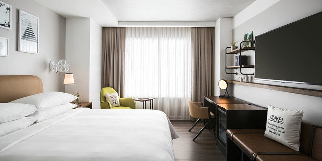 A modern design aesthetic inspired by residential Southern charm awaits guests in each of the hotel's stylish and sophisticated guest rooms and suites. (Courtesy of Isaac Maiselman)