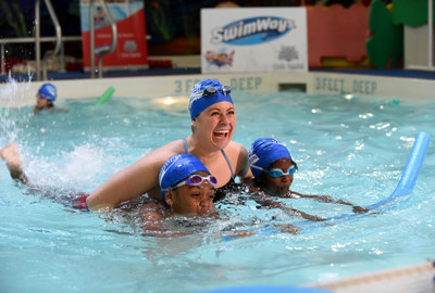 Two-time Olympic medalist and USA Swimming Foundation Ambassador, Elizabeth Beisel, gives swim lessons to children at Imagine Swimming in New York, Thursday, May 18, 2017, to help celebrate Swimways sixth annual National Learn to Swim Day on May 20th. 