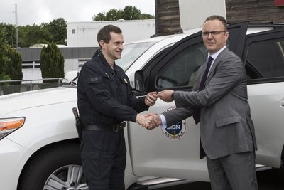Head of GIGN, Colonel Phélip receives keys of armoured SUVs, Fortress Intervention, from Centigon France president, Franck Baucher. (PRNewsfoto/Centigon France)