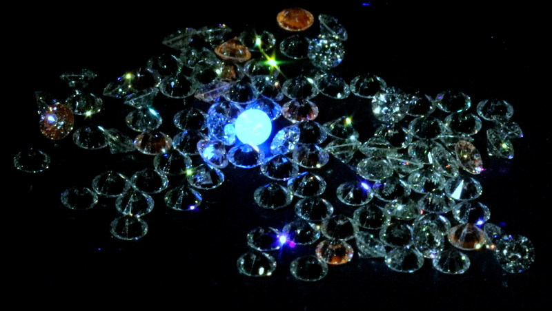 Specialized Gemological Lighting Reveals a Mined Diamond, Glowing Blue