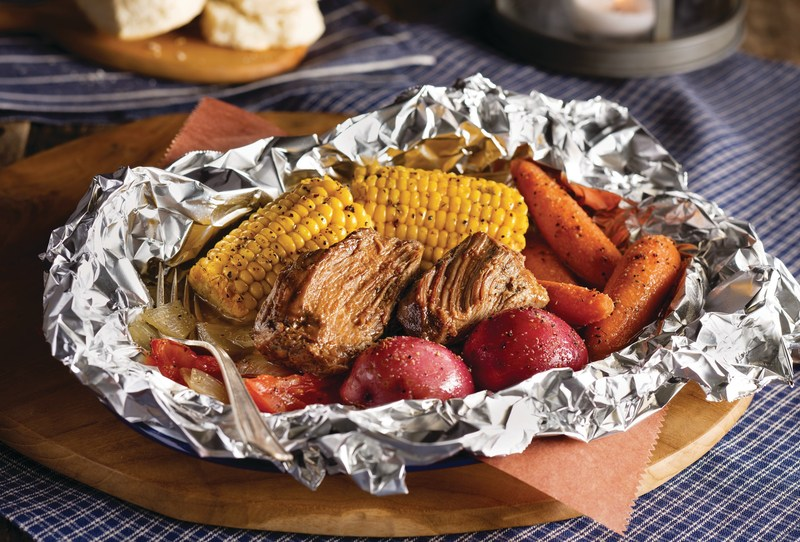 Each Campfire Chicken and Campfire Beef meal is seasoned with Cracker Barrel's signature Campfire Spice blend and slow-cooked in foil with corn on the cob, red skin potatoes, fresh carrots, chopped onion and tomato wedges, served alongside made-from-scratch buttermilk biscuits or corn muffins.