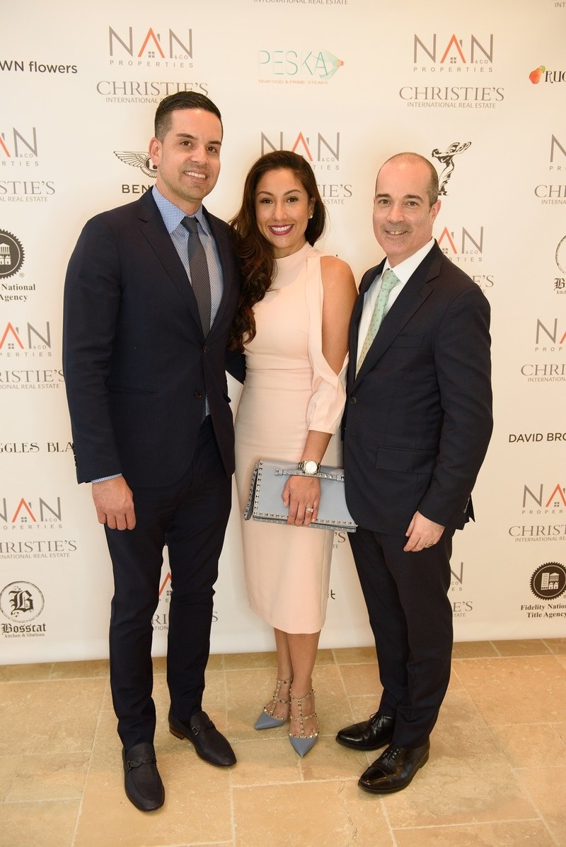 (Left to right) Jose and Nancy Almodovar with Dan Conn, CEO of Christie's International Real Estate