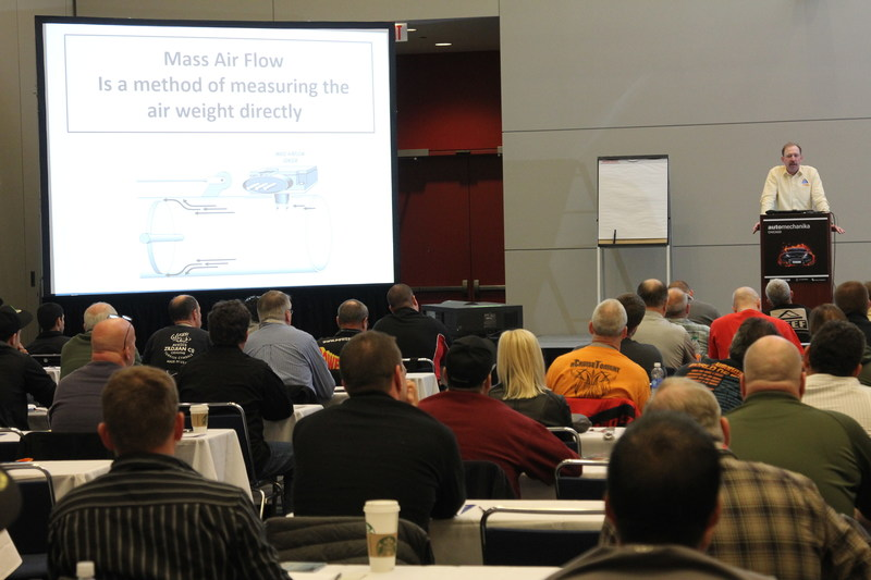 NACE Automechanika trainer teaching a class of over 100 students at Automechanika Chicago 2015