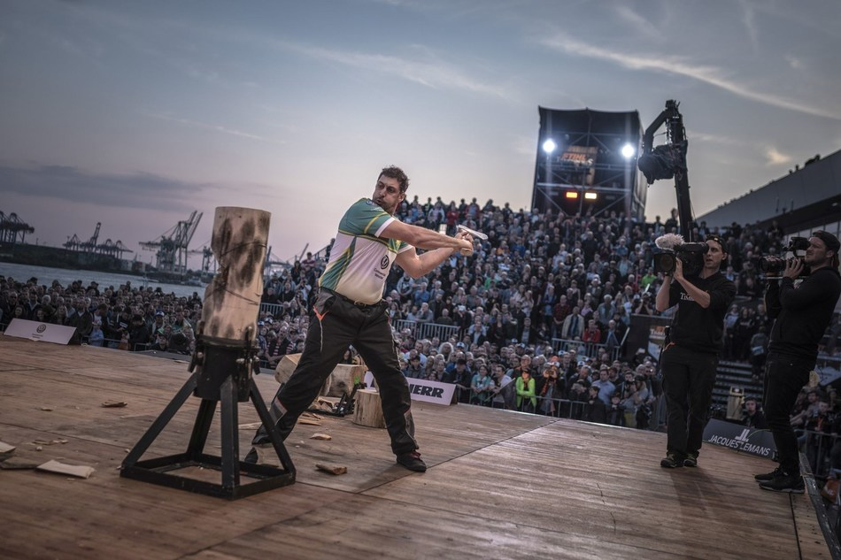 Brad De Losa performs Standing Block Chop in front of the crowd at Cruise Center Altona in Hamburg. (PRNewsfoto/STIHL TIMBERSPORTS)