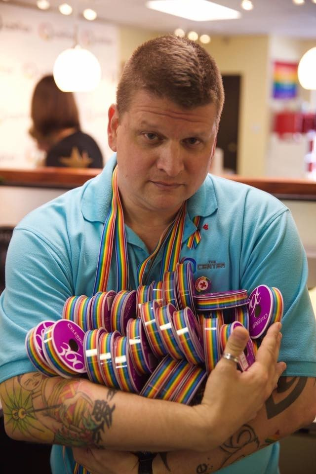 The Orlando Ribbon Project Founder Ben Johansen with spools of rainbow ribbons that helped created thousands of ribbons following the Pulse tragedy on June 12, 2016.