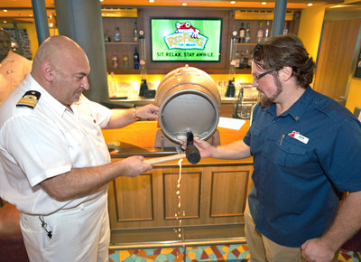 Carnival Vista brewmaster Colin Presby, right, and hotel director Pierre Camilleri tap a traditional 10-gallon firkin cast of the new Miami Guava Wheat beer Saturday, May 20, 2017, on the Carnival Vista in Miami. Brewed by Presby in celebration of American Craft Beer Week at Carnival Vista's RedFrog Pub & Brewery, Miami Guava is being offered to guests on the ship as a limited edition. Carnival Vista sails on six- and eight-day Caribbean cruises from the PortMiami. FOR EDITORIAL USE (Andy Newman/Carnival Cruise Line)