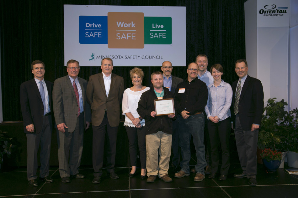 Takeda Earns Minnesota Governor's Safety Award. Shown left to right:  Michael Dougherty, chair, Board of Trustees, Minnesota Safety Council; Bradley W. Oachs, chair, Board of Directors, Minnesota Safety Council; Eric Hahn, site head, Takeda Brooklyn Park; Darnelle Landis, sr. HR business partner, Takeda; Rich Mastro, warehouse associate III Takeda; Jim Lauterbach, director, engineering & facility operations, Takeda; Dave Vechart, sr. maintenance technician, Takeda; Joe Michalski, site environment, health & safety manager, Takeda; Charlene Lee, quality control analyst II, Takeda; Paul W. Aasen, president, Minnesota Safety Council