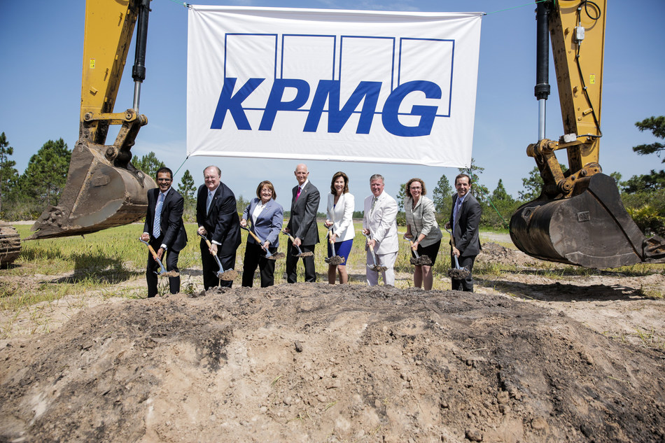 KPMG Chairman and CEO Lynne Doughtie (center right) and Florida Governor Rick Scott (center left) joined by other leaders at groundbreaking ceremony for KPMG's learning, development and innovation facility.