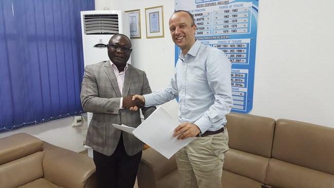 RMU Vice Chancellor Elvis Nyarko and Redavia CEO Erwin Spolders signing contract
