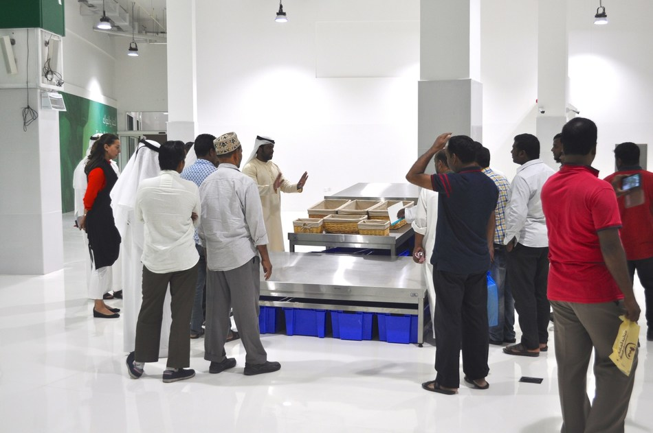 Traders getting a tour of the new market (PRNewsfoto/GEM Global Event Management)