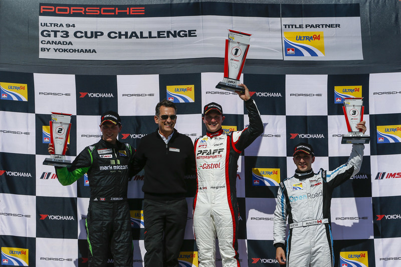 Scott Hargrove won Round 1 of the 2017 Porsche Ultra 94 GT3 Cup Challenge Canada by Yokohama in the No. 9 Castrol-Pfaff Motorsports entry. Zacharie Robichon finished second in the No. 98 Mark Motors Racing Porsche two seconds behind Hargrove; series newcomer Remo Ruscitti in the No. 69 OpenRoad Racing entry rounded out the Platinum class podium. Alexander Pollich, President and CEO of Porsche Cars Canada, Ltd. is pictured on the podium after presenting the finishers their respective awards. (CNW Group/Porsche Cars Canada)