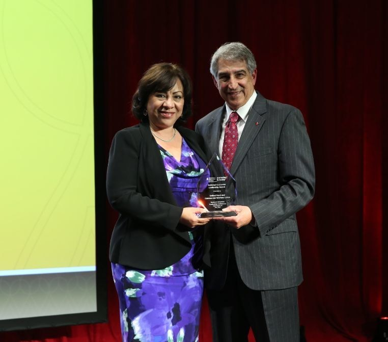 Esther López, UFCW's International Secretary-Treasurer, accepting the National Corporate Leadership Award from Louis J. DeGennaro, Ph.D., The Leukemia & Lymphoma Society's (LLS) president and CEO, at LLS's Volunteer Leadership Conference awards dinner held in Washington, D.C., on May 2, 2017.