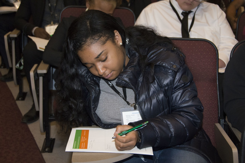 A student fills out a worksheet during a presentation at the recent Siegfried Leadership Program™ event