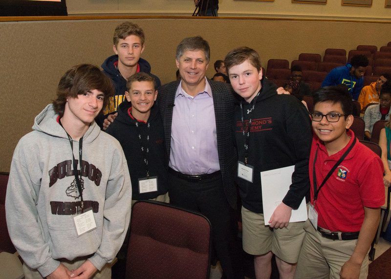 Rob Siegfried, CEO and Founder of The Siegfried Group, LLP and co-founder of the Siegfried Leadership Program™, poses for a photo with several students from St. Edmond's Academy.