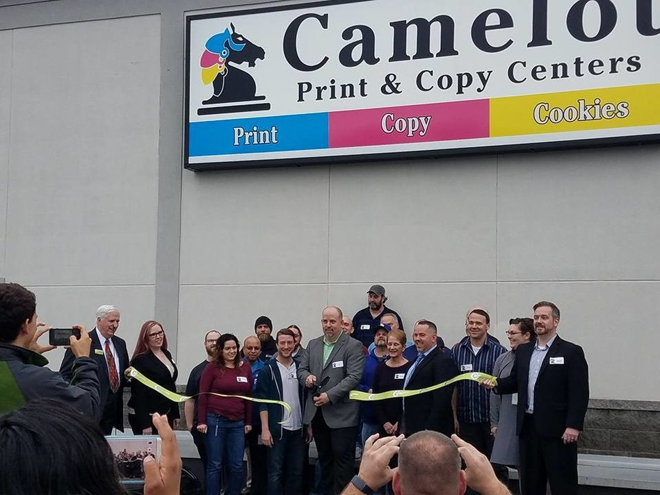 The Camelot team shown here during their recent Grand Opening of a new office.