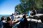 Students pick up litter at Woodbine Beach in Toronto, Ont. (c) Peter Nguyen (CNW Group/WWF-Canada)