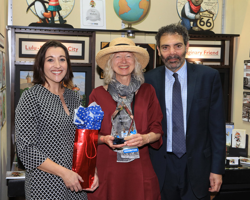 License Global's 'One to Watch' 2017 winner, artist Renée Graef for Lulu. Pictured with Jessica Blue, senior vice president, licensing, UBM, and Steven Ekstract, group publisher, License Global.