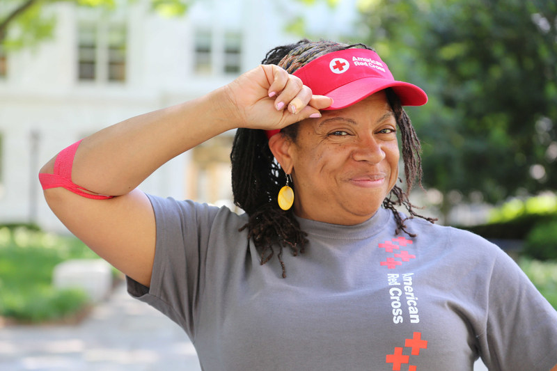 Blood donor Dawn sports a Red Cross visor after rolling up a sleeve to help save lives. Those who come to give blood or platelets from May 26-30 will receive this special thank you, while supplies last.