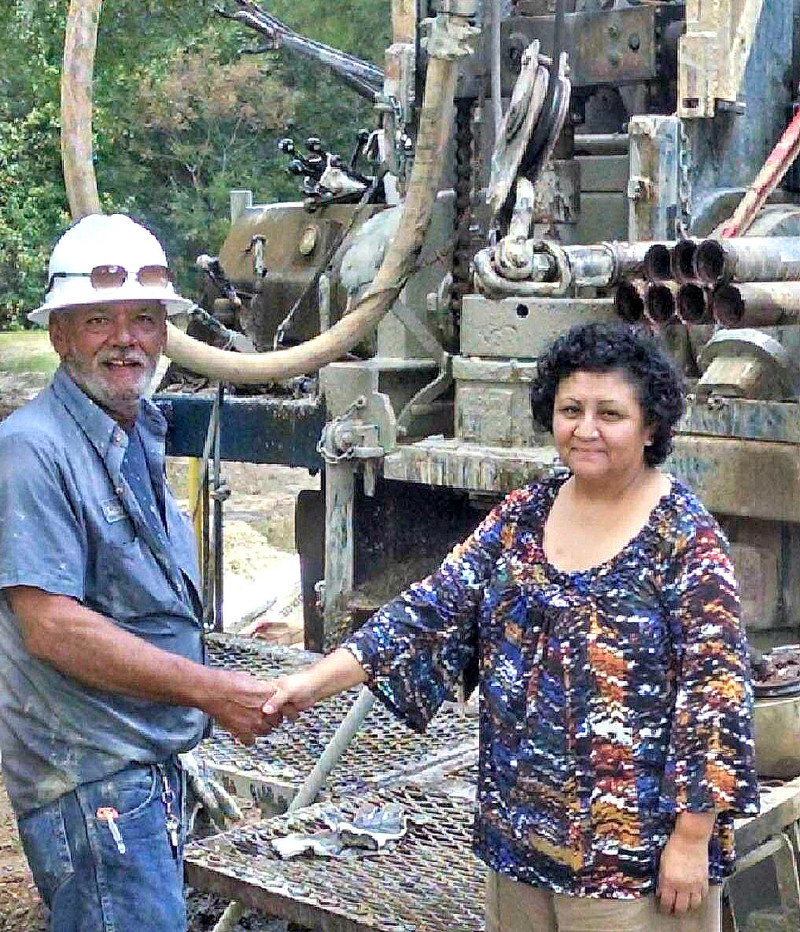Colquitt County GA resident Ruth Doss thanks driller from Bishop Well & Pump for work on her new water well.