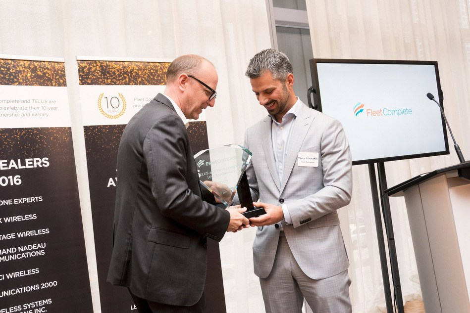 Tony Lourakis, Fleet Complete CEO and Michael Cihra, TELUS VP of Internet of Things celebrate a decade together with Fleet Achievement Awards, recognizing their clients in Canada. (CNW Group/Fleet Complete)