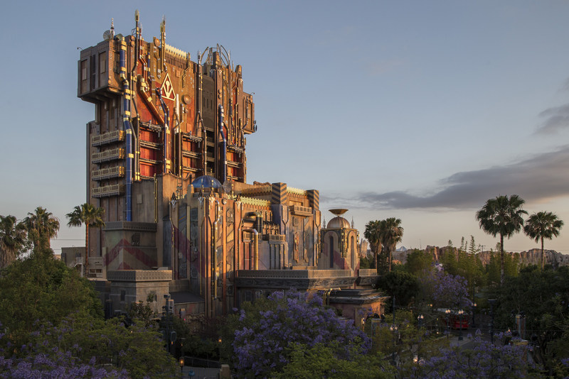 """Guardians of the Galaxy--Mission: BREAKOUT! — The exterior of The Collector's Fortress shimmers at dusk at Disney California Adventure Park, enticing guests to explore the new attraction Guardians of the Galaxy–Mission: BREAKOUT!  The epic new adventure blasts guests straight into the """"Guardians of the Galaxy"""" story for the first time, alongside characters from the blockbuster films and comics. Rocket is asking guests to help him rescue his pals from The Collector's grandiose Fortress. (Joshua Sudock/DIsneyland Resort)"""