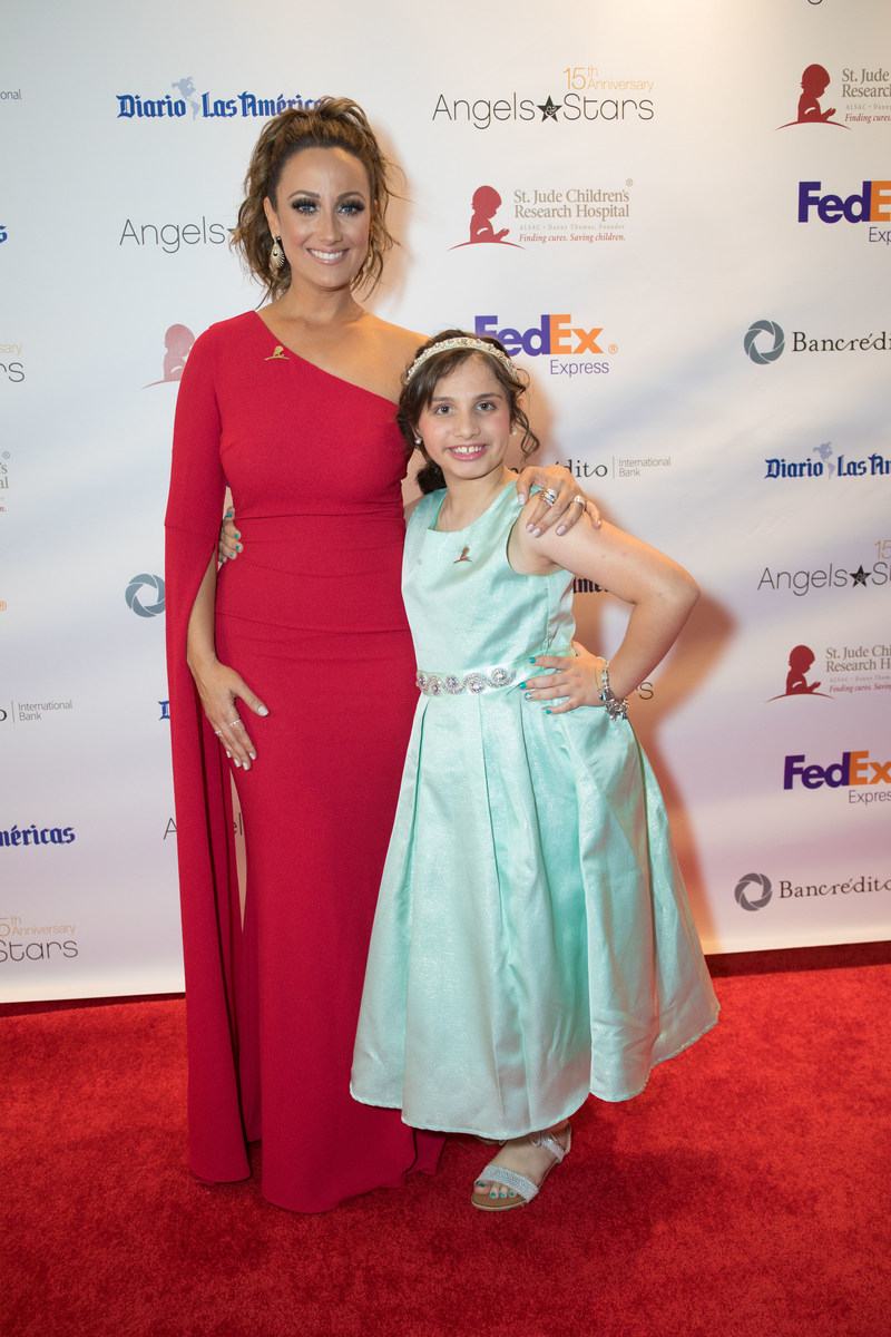 Karla Monroig with St. Jude patient Victoria on the red carpet at the 15th annual FedEx St. Jude Angels & Stars Miami Gala (PRNewsfoto/St. Jude Children's Research Ho)