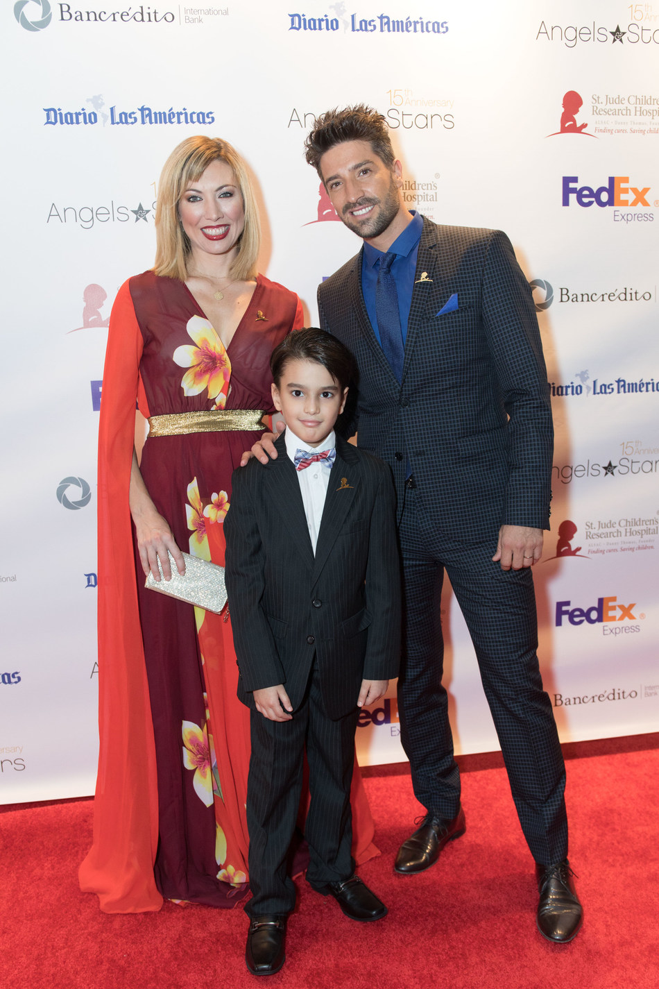 David Chocarro & Carolina Laursen with St. Jude patient Hender on the red carpet of the 15th annual FedEx St. Jude Angels & Stars Miami Gala on Saturday May 20th
