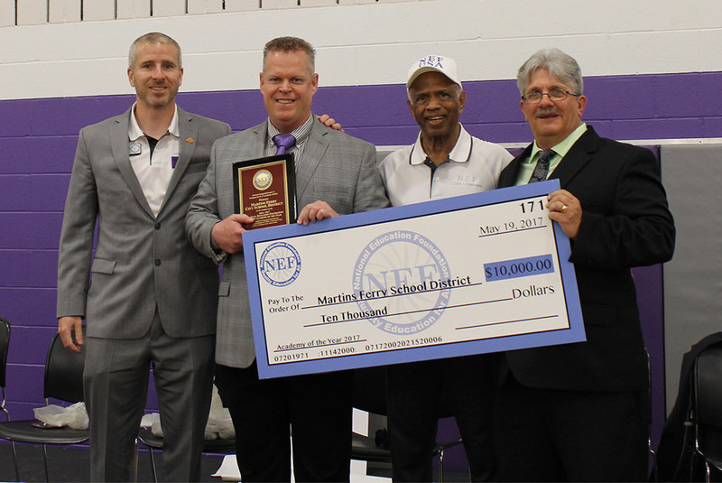 NEF Chairman Dr. Kuttan (third from left) presents the 2017 STEM Leadership Award of $10,000 to Martins Ferry Schools, OH