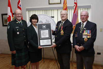 From left: Kirk MacRae, Member of the Royal Canadian Mint Board of Directors and Ginette Petitpas Taylor, MP (Moncton - Riverview - Dieppe) present the 75th Anniversary of the Battle of Dieppe silver collector coin to Robert Dupuis, President, Moncton Branch of the Royal Canadian Legion (Moncton, NB, May 25, 2017) (CNW Group/Royal Canadian Mint)