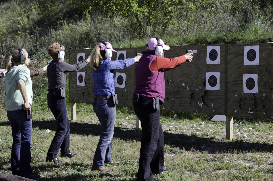 A group participates in target practice at Hillsdale College's Ladies for Liberty Shooting Camp and Seminar.