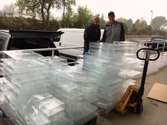 Organize My Drawer CEO Wayne Qualkinbush with Resource Area For Teaching Colorado warehouse manager Alex Smith, unload donated organizers on May 18, 2017. Photo by Kristen Kidd