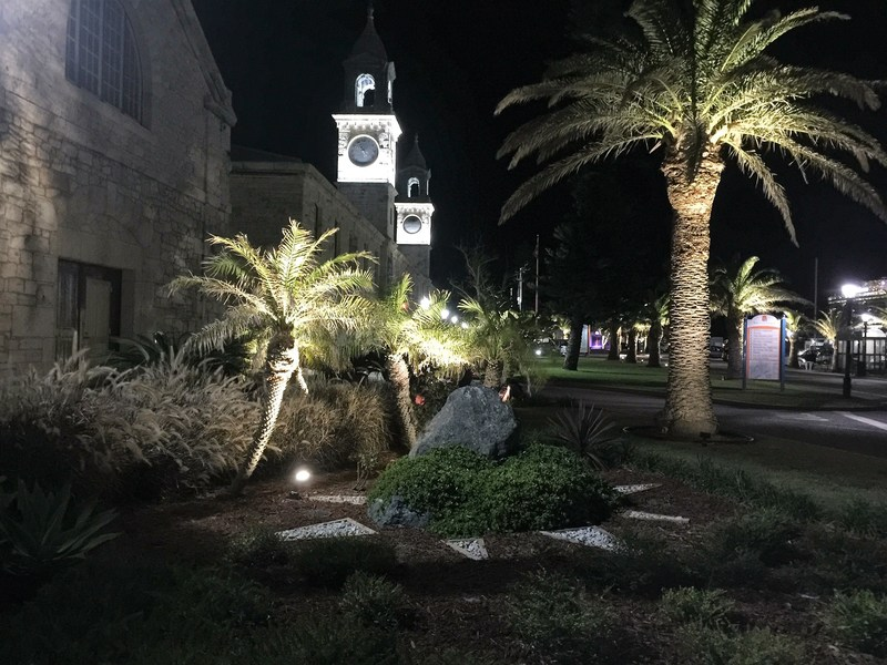 The iconic twin clock towers of Bermuda's Royal Naval Dockyard lit up by Kopa Group.