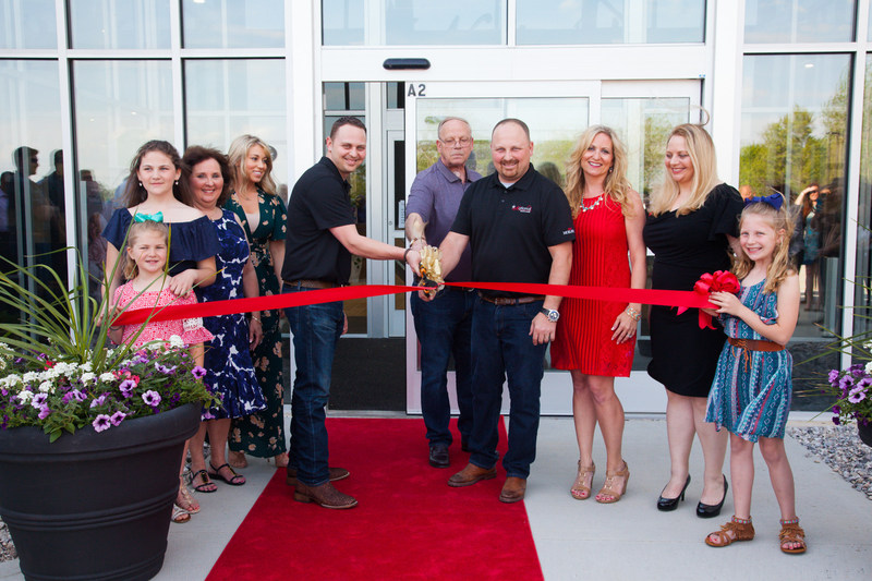 Ryan, Dennis and Chris King cut the ribbon at National Design Mart's VIP Grand Opening Event.